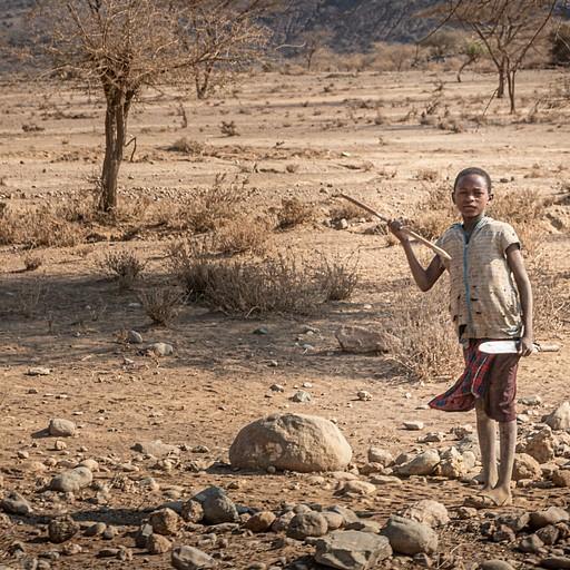 ילד בן שבט מסאי מנופף בחנית וחרב