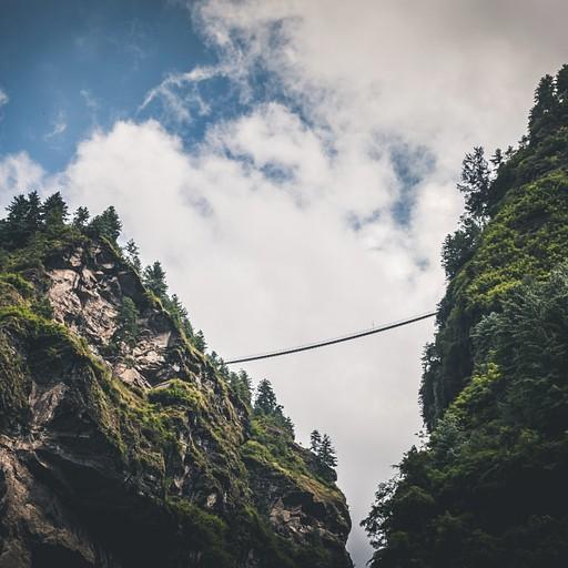 גשר תלוי מאות מטרים באוויר ואנשים חוצים עליו. לא ברור לי בין אילו כפרים הוא מחבר